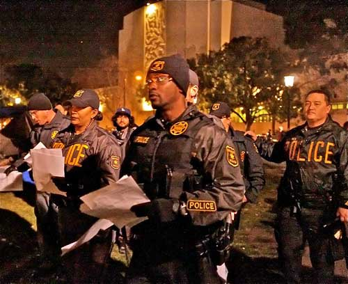 Prelude to a clash. Berkeley police came through the Occupy Berkeley General Assembly meeting Wednesday nite with a list of homeless shelters. Earlier, they announced they would enforce park rules, which restrict camping in Civic Center Park. The encampment braced for an eviction at 10p.m.